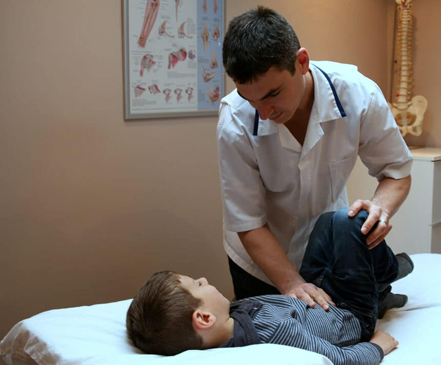 Leor Okrent treating a young patient at Finchley Osteopathy