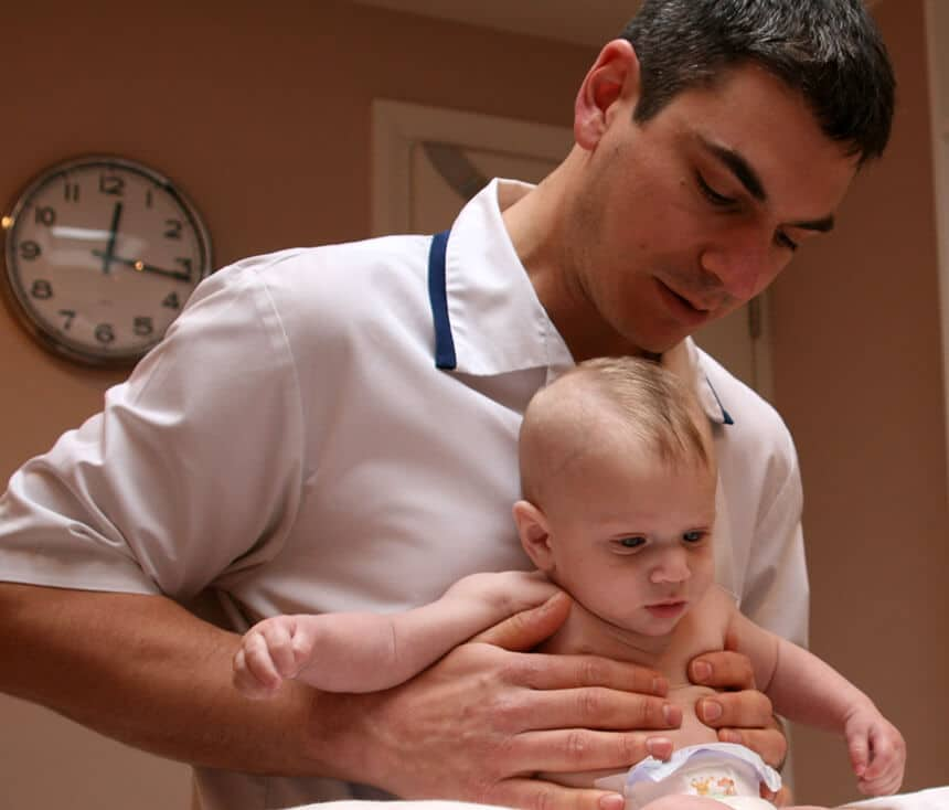 Leor Okrent treating a baby patient at Finchley Osteopathy